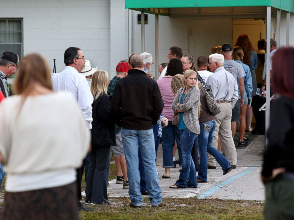 PHOTO: Voters wait in a queue to cast their ballots in the presidential election at a polling station in Christmas, Florida, Nov. 8, 2016.