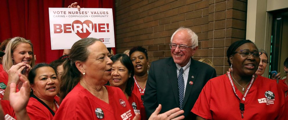 """PHOTO: Presidential candidate U.S. Sen. Bernie Sanders (I-VT) greets nurses as he arrives at a """"Brunch with Bernie"""" campaign rally at the National Nurses United offices on Aug. 10, 2015 in Oakland, Calif."""