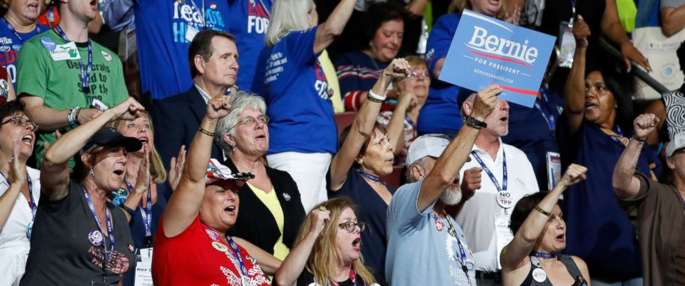 "PHOTO: Delegates chant ""Bernie"" during the first day of the Democratic National Convention, July 25, 2016 in Philadelphia, Pennsylvania."