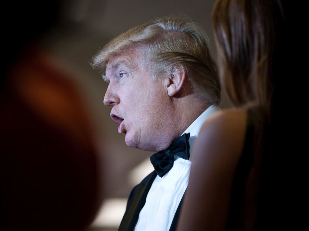 PHOTO: Donald Trump talks with other guests at the White House Correspondents Association dinner in Washington, April 30, 2011.