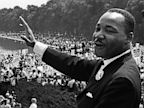 PHOTO: Civil rights leader Martin Luther King Jr. waves to supporters during March on Washington, Aug. 28, 1963.