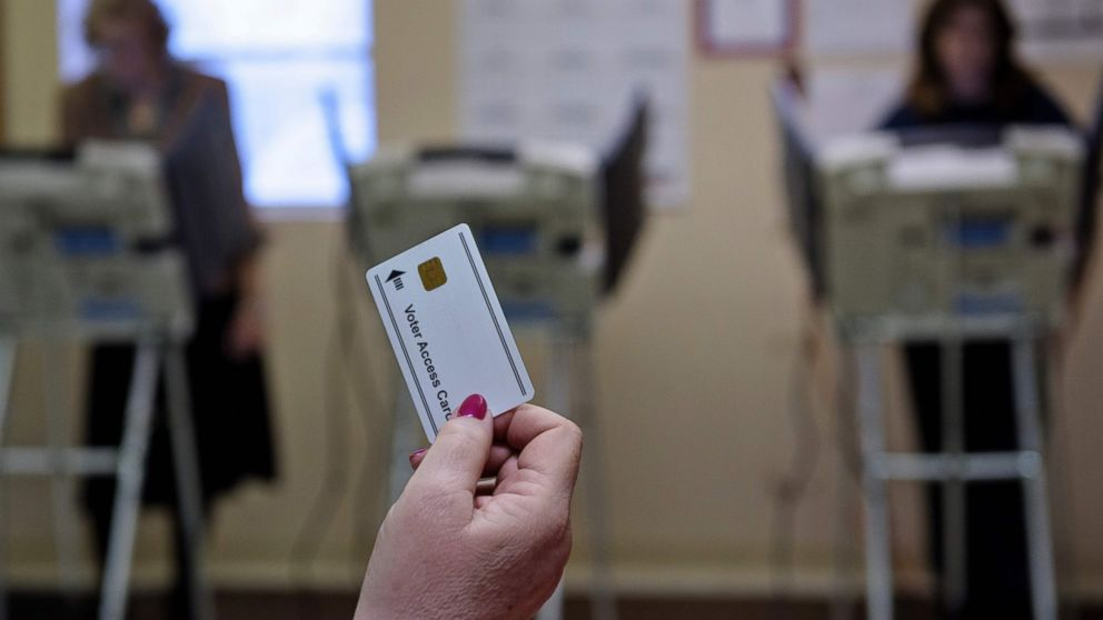 A poll worker waits to give a voter a card necessary for electronic voting in Stark County-Beach City, Ohio on March 15, 2016.