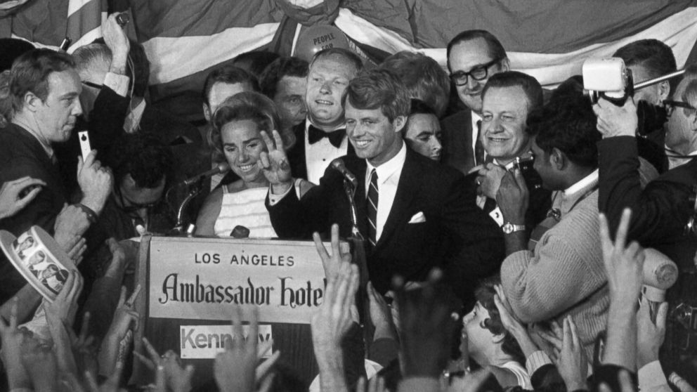 Sen. Robert Kennedy gives a  victory sign to a crowd at the Ambassador Hotel June 5, 1968, after winning the California primary. A few minutes later, he was brought down by an assassin's bullets upon entering a hotel corridor.