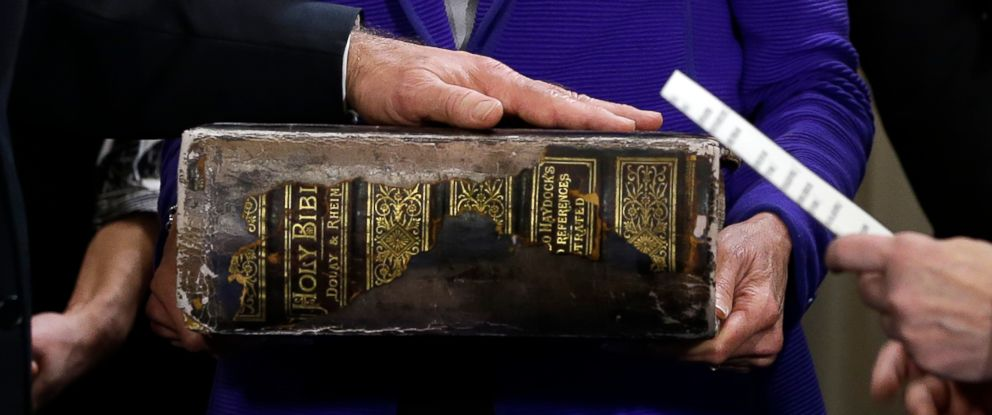 PHOTO: US Vice President Joe Biden (L) places his hand on the Biden family Bible as he takes the oath of office from Supreme Court Justice Sonia Sotomayo during and official ceremony at the Naval Observatory on Jan. 20, 2013 in Washington.