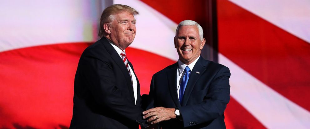 PHOTO: Republican presidential candidate Donald Trump with Republican vice presidential candidate Mike Pence after he delivered a speech on the third day of the Republican National Convention on July 20, 2016 at the Quicken Loans Arena in Cleveland.
