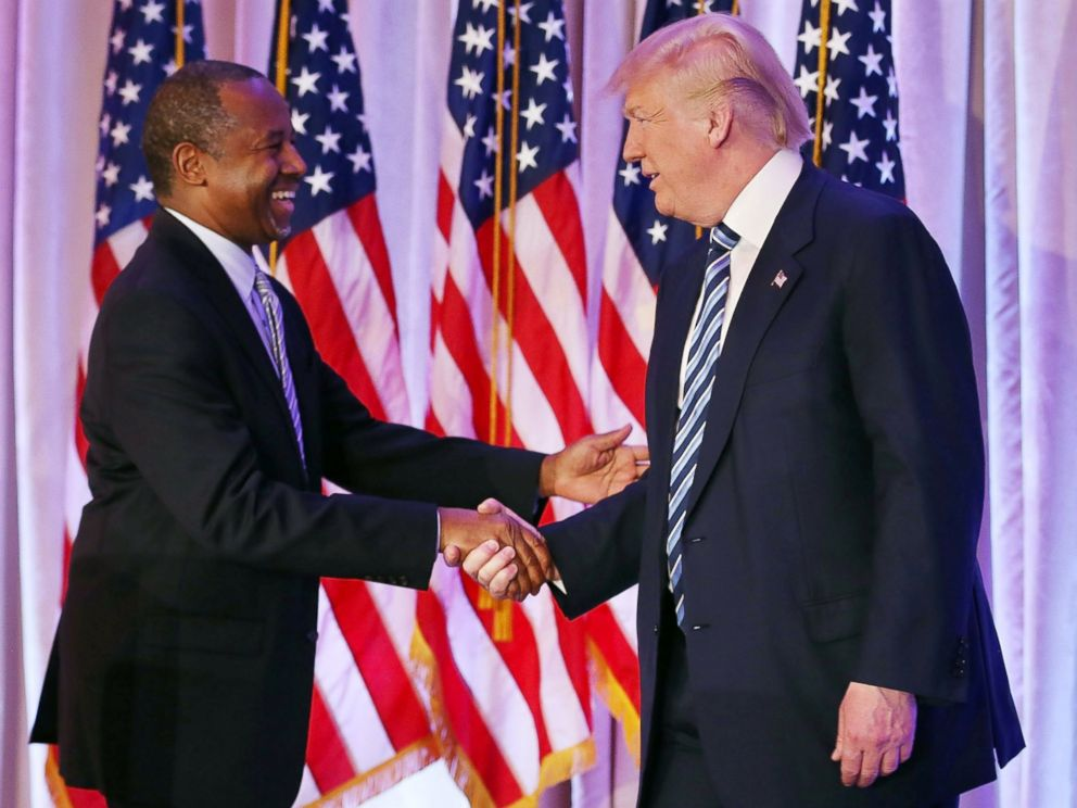 PHOTO: Republican presidential candidate Donald Trump shakes hands with former presidential candidate Ben Carson as he receives his endorsement at the Mar-A-Lago Club on March 11, 2016 in Palm Beach, Florida.