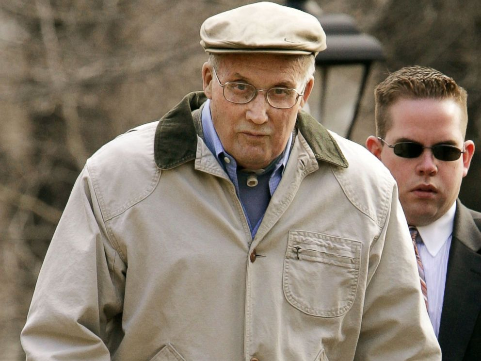 PHOTO: William Rehnquist leaves his house March 21, 2005 in Arlington, Virginia with a member of his security detail.