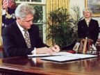 PHOTO: President Bill Clinton exercises his line-item veto authority in the Oval Office of the White House, Aug. 11, 1997.