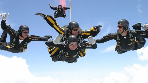 PHOTO: George H.W. Bush, bottom center, performs a tandem parachute jump on June 13, 2004 over the Bush Presidential Library in College Station, Texas.