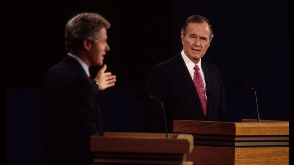 Bill Clinton and George H.W. bush are seen here at a presidential debate, Oct. 19, 1992, in East Lansing, Mich.