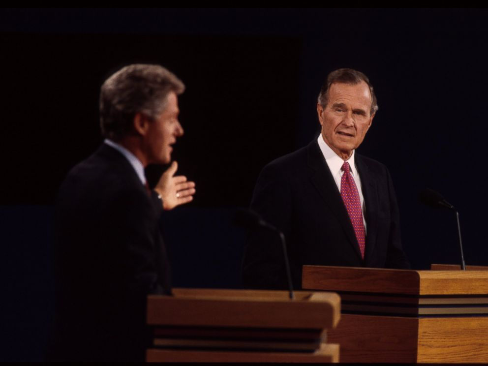 PHOTO: Bill Clinton and George H.W. bush are seen here at a presidential debate, Oct. 19, 1992, in East Lansing, Mich.