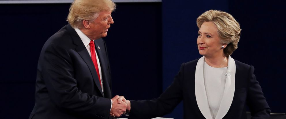 PHOTO: Donald Trump shakes hands with Hillary Clinton during the town hall debate at Washington University, Oct. 9, 2016, in St Louis, Missouri.