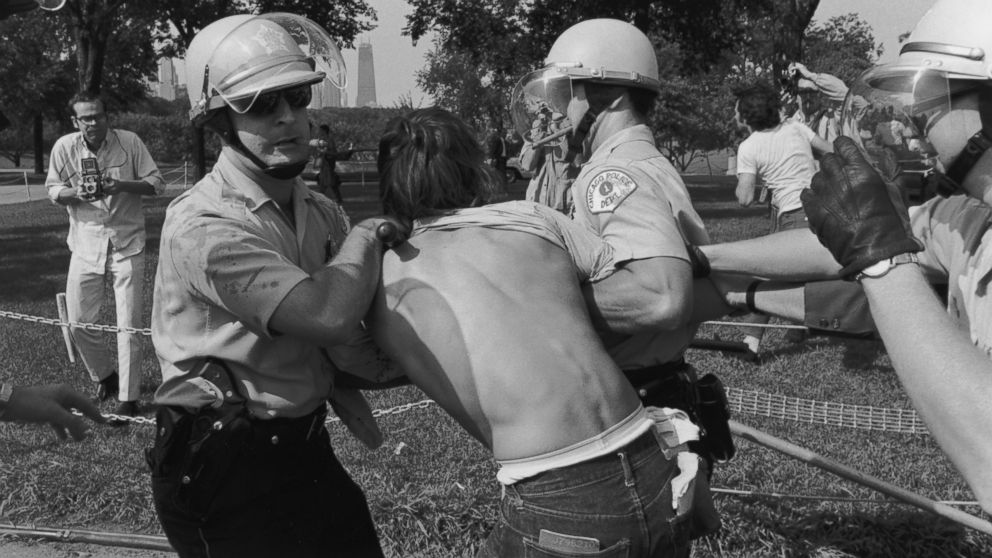 Police officers arrest a protester at a riot in Grant Park during the Democratic National Convention in Chicago, Aug. 28, 1968.