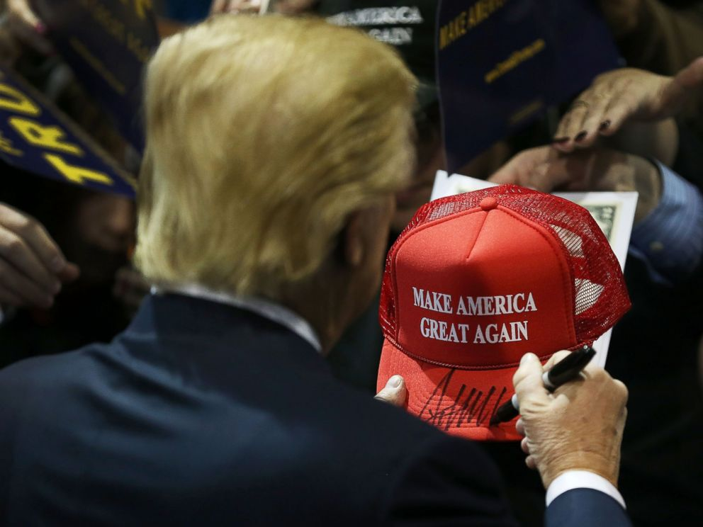 PHOTO:Donald Trump signs one of his campaign hats during a event at the University of Northern Iowa, Jan. 12, 2016, in Cedar Falls, Iowa.