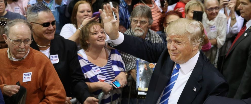 PHOTO: Presidential candidate and Republican front-runner Donald Trump shakes hands and gives autographs during a campaign rally at the Richmond International Raceway, Oct. 14, 2015 in Richmond, Va.