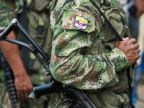 PHOTO: Members of the Revolutionary Armed Forces of Colombia (FARC) guerrillas, guard the mountainous region of the department of Cauca, around Montealagre, Colombia, on Feb. 15, 2013.