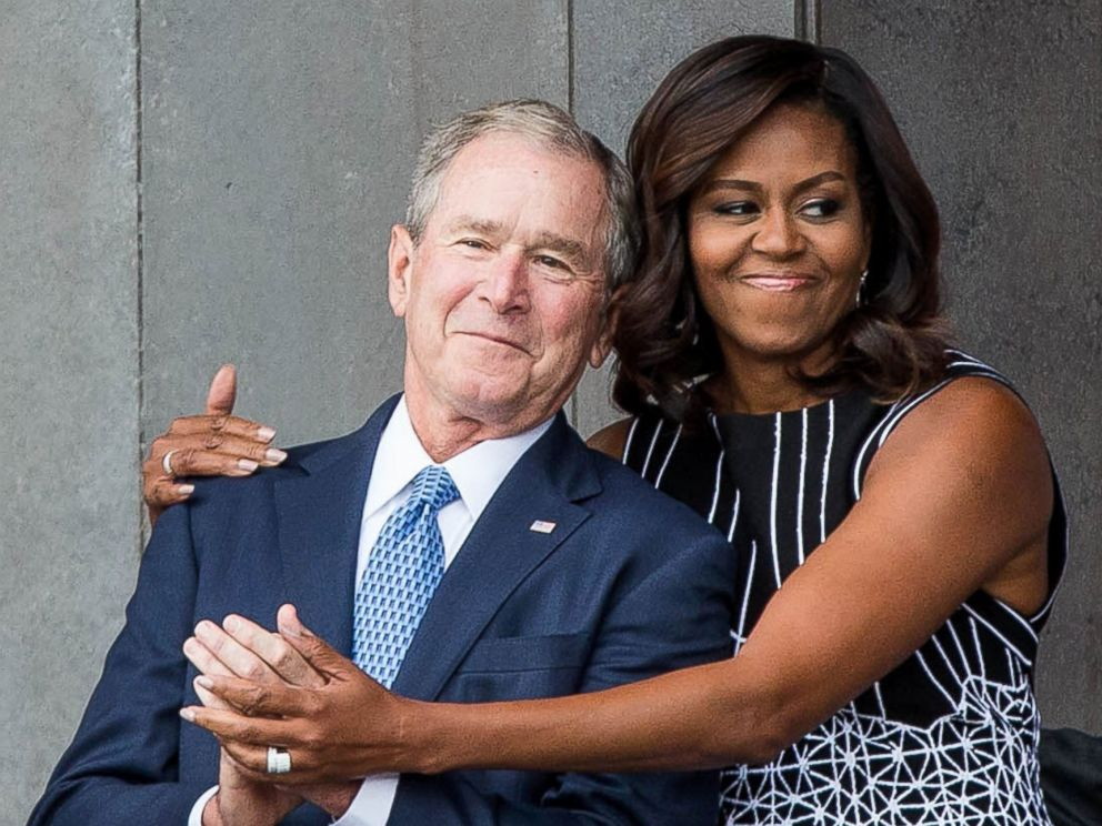 PHOTO Former President George W Bush Receives A Hug From First Lady Michelle Obama