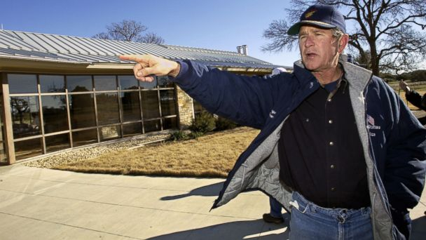 PHOTO: George W. Bush points out features of his Texas house to reporters during a tour of Praire Chapel Ranch, Jan 2, 2003, near Crawford, Texas. The President and his family have been vacationing on the ranch over the New Years Day holiday.