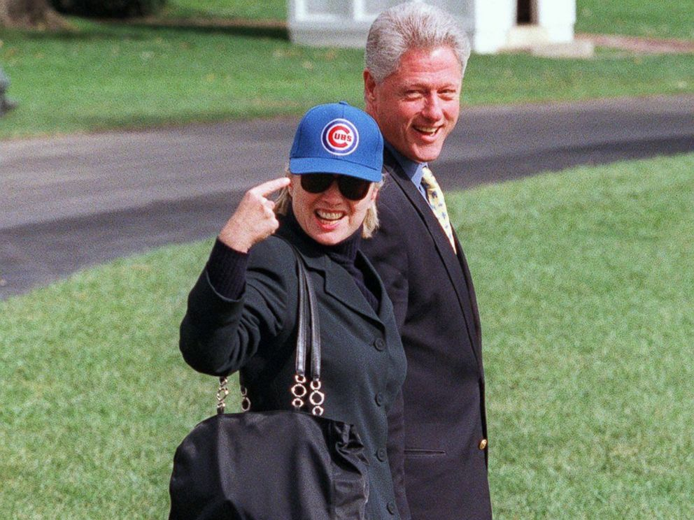 PHOTO: Then first lady Hillary Clinton points to her Chicago Cubs baseball cap on the South Lawn of the White House with husband, then President Bill Clinton and their dog, Buddy, Oct. 3, 1998.