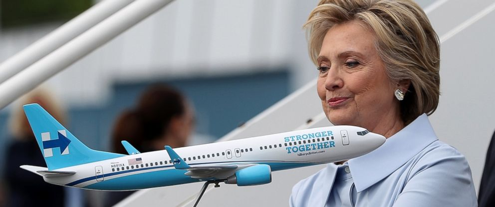 PHOTO: Democratic presidential nominee former Secretary of State Hillary Clinton looks at a scale model of her new campaign plane at Westchester County Airport, Sept. 5, 2016 in White Plains, New York.