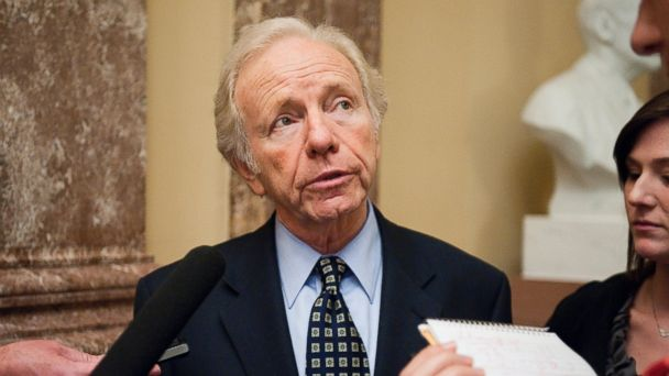 PHOTO: Sen. Joe Lieberman, I-Conn., speaks with reporters as he arrives for the Senate Democratic Policy Committee lunch on Wednesday, Oct. 12, 2011.