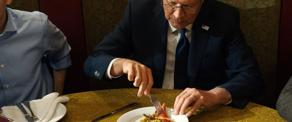 PHOTO: John Kasich eats a piece of pizza at Ginos Pizzeria and Restaurant, March 30, 2016, in the Queens borough of New York City.
