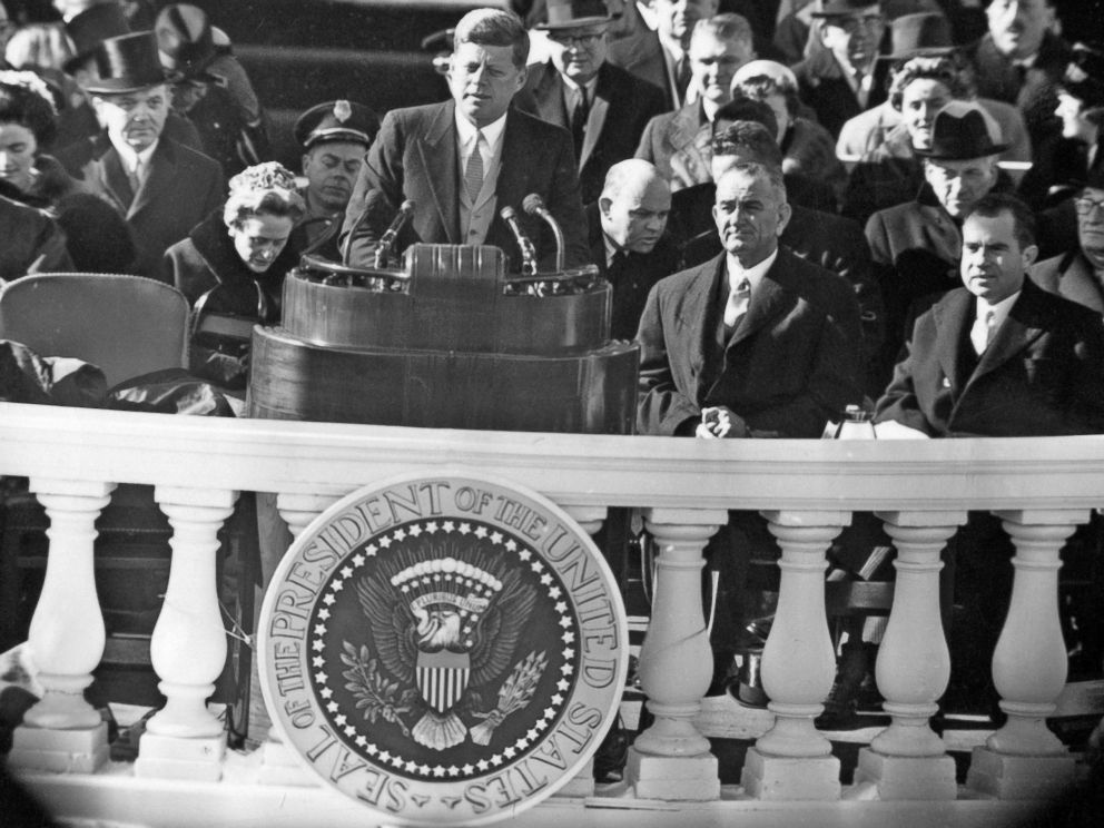 PHOTO: John F. Kennedy delivers his inauguration address, Jan. 20, 1961. Seated behind him are Lyndon B. Johnson and Richard Nixon, the man he defeated.