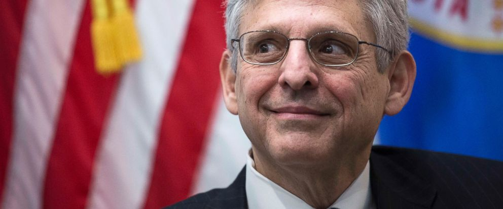 PHOTO: Merrick Garland looks on during a photo opportunity before a private meeting with Sen. Al Franken (D-MN) in Frankens office on Capitol Hill, March 30, 2016, in Washington.