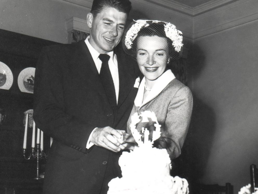 PHOTO:Ronald and Nancy Reagan cutting cake following their wedding ceremony.