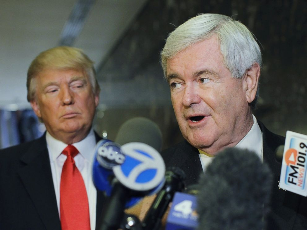 PHOTO: Newt Gingrich speaks to the media as Donald Trump listens at Trump Tower following a meeting between the two, Dec. 5, 2011, in New York.