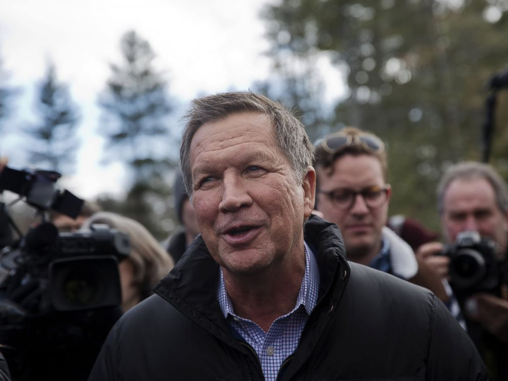 PHOTO: John Kasich, governor of Ohio and Republican presidential candidate, center, greets voters while arriving at a polling station in Concord, N.H., Feb. 9, 2016.