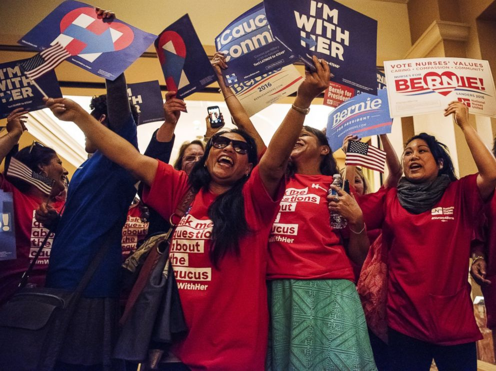 PHOTO:Supporters of Hillary Clinton and Sen. Bernie Sanders hold campaign signs before casting their vote for a Democratic presidential candidate ahead of the Nevada Democratic presidential caucus at Caesars Palace in Las Vegas, Feb. 20, 2016.