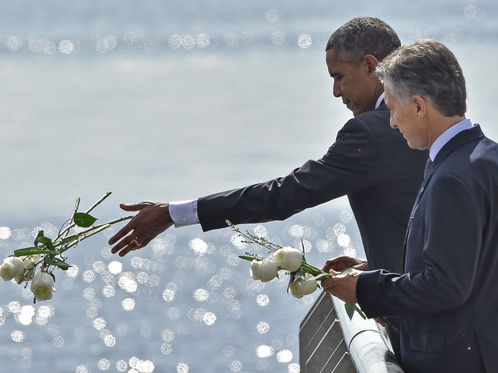 PHOTO:President Obama and Argentinian President Mauricio Macri throw white flowers into the River as they pay homage to Dirty Wars victims at the Parque de la Memoria in Buenos Aires, March 24, on the 40th anniversary of the 1976 military coup.