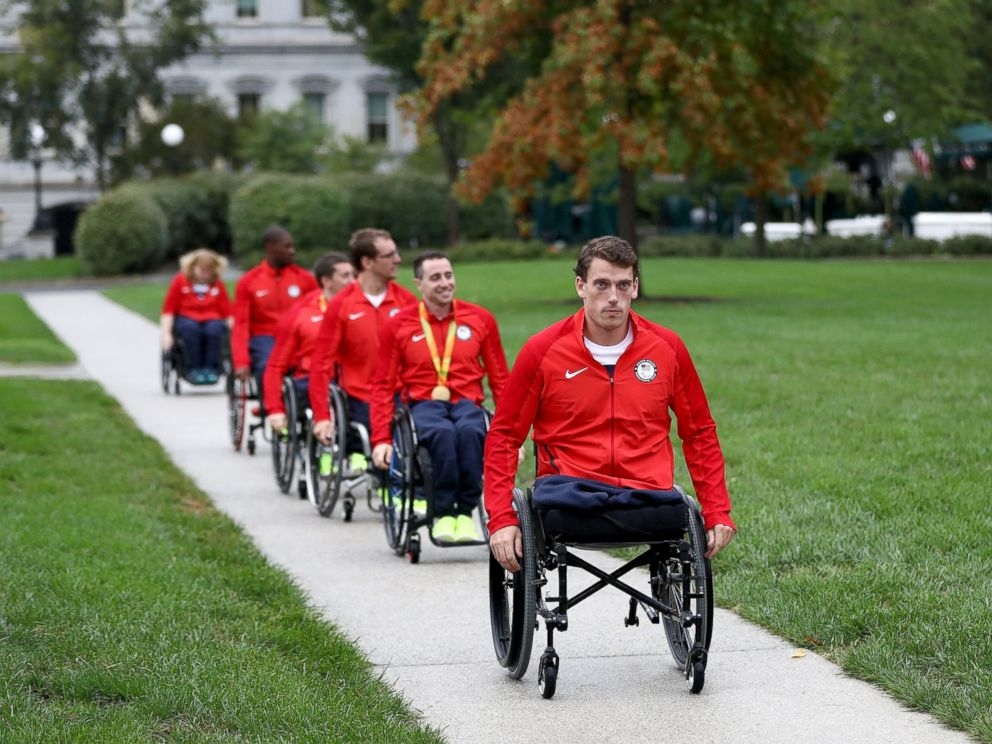 PHOTO: Members of the Paralympic team head to East Room of the White House, Sept. 29, 2016, in Washington.