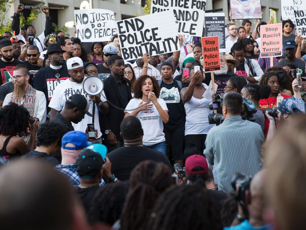 PHOTO: People rally in Dallas, Texas, July 7, 2016 to protest the deaths of Alton Sterling and Philando Castile.