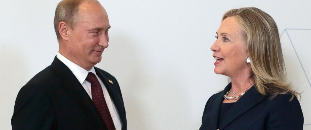 PHOTO: Russian President Vladimir Putin listens to Secretary of State Hillary Clinton during the Asia-Pacific Economic Cooperation (APEC) Summit, Sept. 8, 2012.