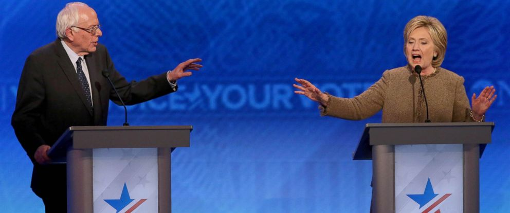 PHOTO: Democratic president candidates Bernie Sanders and Hillary Clinton debate at Saint Anselm College, Dec. 19, 2015, in Manchester, New Hampshire.
