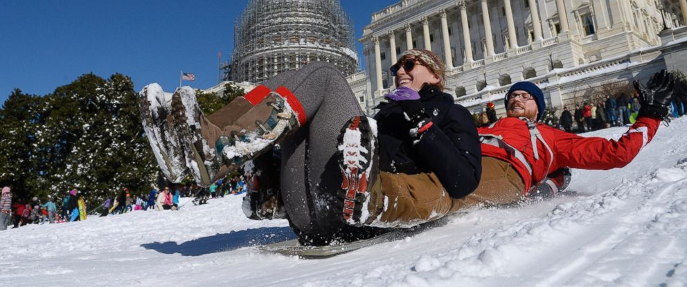 PHOTO: People are sliding on the West Lawn of the U.S. Capitol, Jan. 24, 2016 in Washington.
