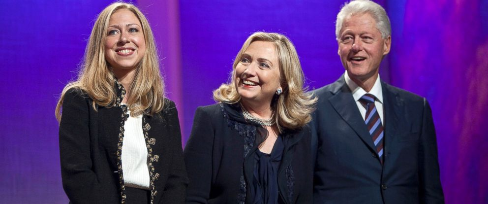 PHOTO: Former U.S. President Bill Clinton, right, smiles with Hillary Clinton, former U.S. secretary of state, and daughter Chelsea Clinton at the closing session of the Clinton Global Initiative annual meeting in New York, Sept. 22, 2011.