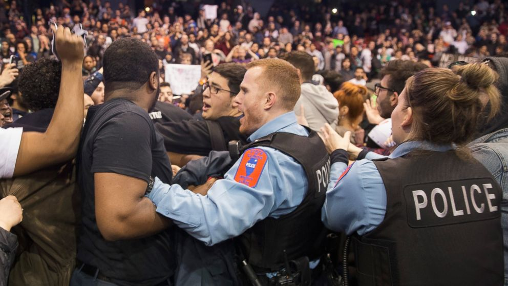 Police break up skirmishes between demonstrators and supporters of Republican presidential candidate Donald Trump that broke out after it was announced a rally at the University of Illinois at Chicago would be postponed, March 11, 2016, in Chicago.