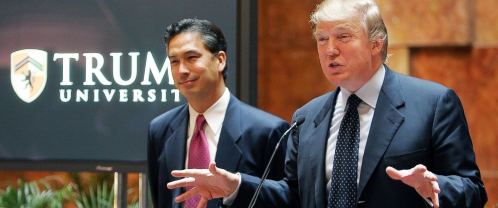 PHOTO: Donald Trump speaks as university president Michael Sexton, left, looks on during a news conference announcing the establishment of Trump University, May 23, 2005 in New York City.