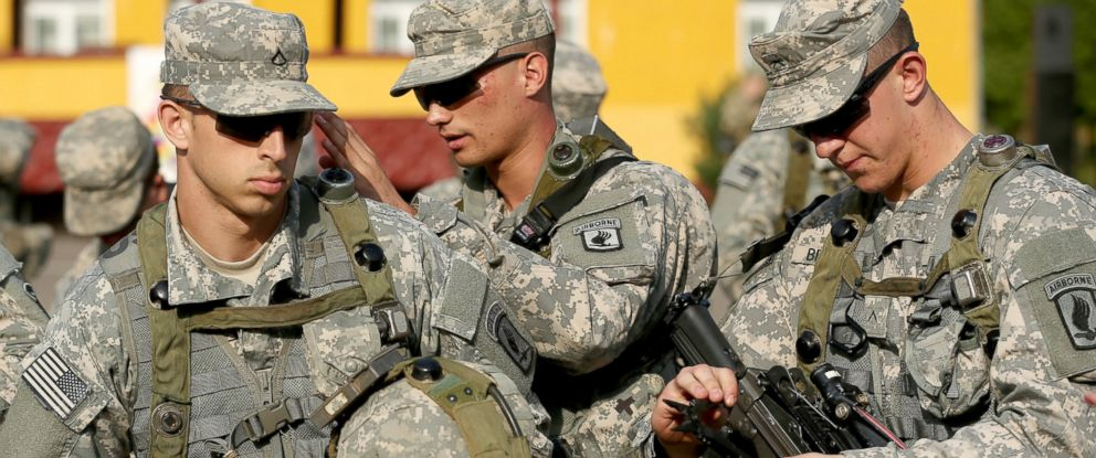 """PHOTO: Members of the U.S. Army 173rd Airborne Brigade prepare weapons and equipment following the opening ceremony of the """"Rapid Trident"""" NATO military exercises, Sept. 15, 2014, in this file photo."""