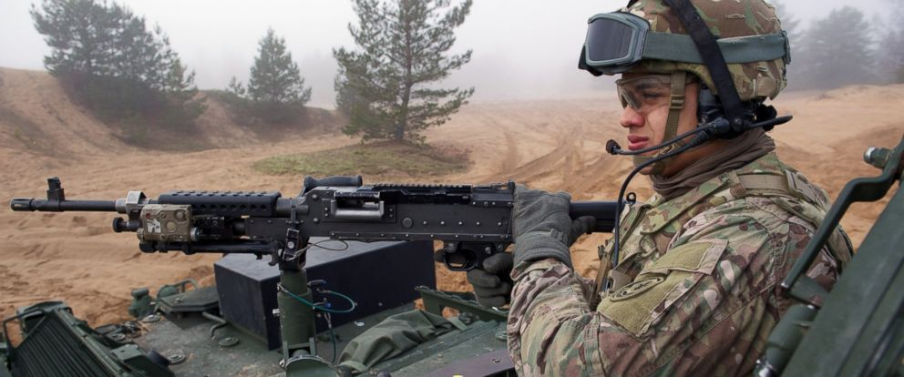 PHOTO: A soldier is shown manning a gun on an armored fighting vehicle IAV Stryker of the U.S. Cavalry Regiment 2nd subdivision during a partner training with Latvian an Canadian soldiers at the Adazi military training area in Latvia, Feb. 26, 2015.