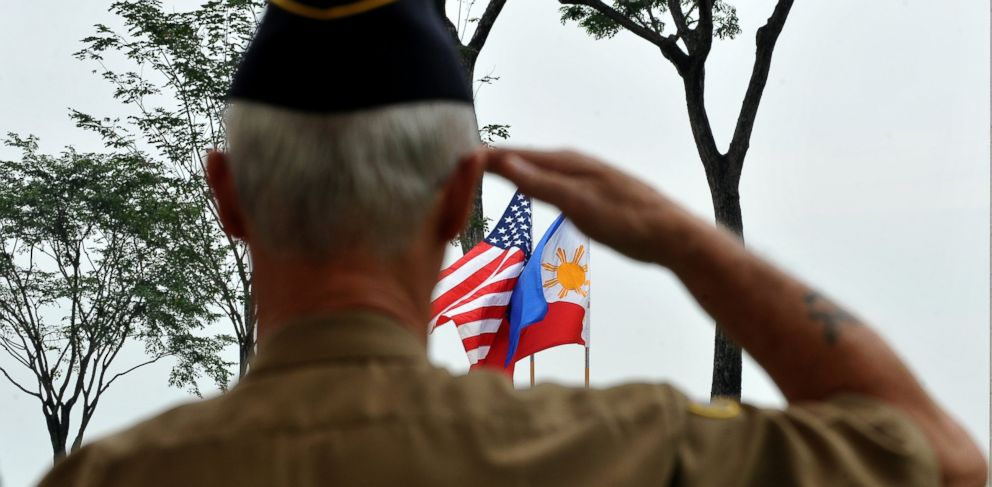 PHOTO: A retired American soldier salutes to the colors during Veterans Day celebration at the American Cemetery in Manila, Nov. 11, 2010.