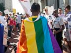PHOTO: A same-sex marriage supporter wears a rainbow cape behind 4th U.S. Circuit Court of Appeals after a court hearing, May 13, 2014, in Richmond.