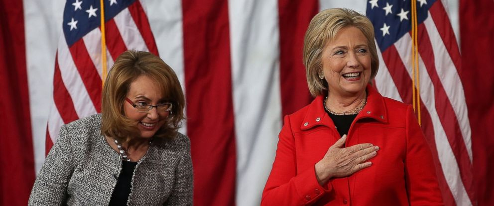 "PHOTO: Former Sen. Gabrielle Giffords, left, looks on as democratic presidential candidate former Secretary of State Hillary Clinton speaks during a ""get out the caucus"" event at Iowa State University, Jan. 30, 2016 in Ames, Iowa."