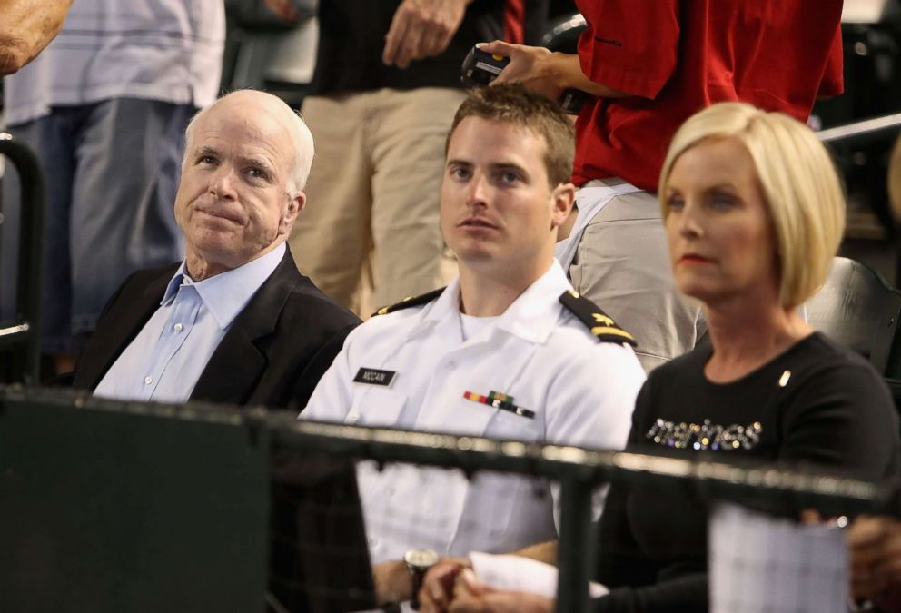 U.S. Sen. John McCain (R-AZ), U.S. Navy ensign Jack McCain and wife Cindy McCain attend the major league baseball game between the San Diego Padres and the Arizona Diamondbacks at Chase Field on May 25, 2009 in Phoenix, Arizona.