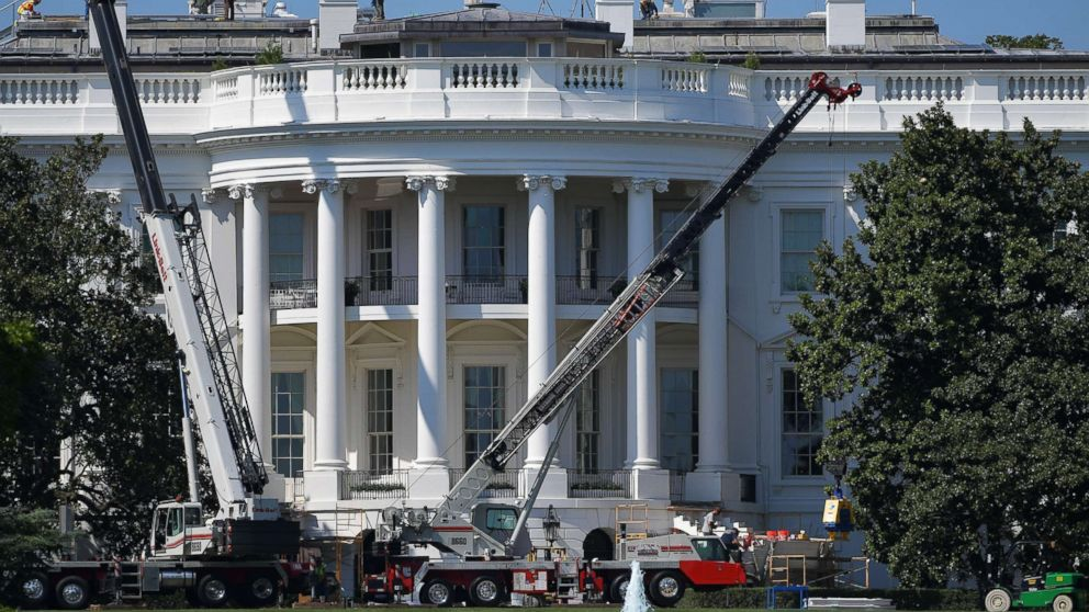 Cranes are seen infront of the south front of the White House as it undergoes renovations on August 9, 2017 in Washington, DC.