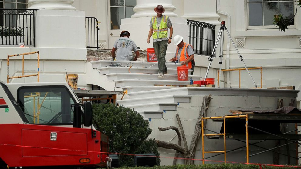 WASHINGTON, DC - AUGUST 11:  Workers repair the South Portico steps, part of a large renovation project at the White House August 11, 2017 in Washington, DC. The Government Services Administration is overseeing the rennovation work during the two week project to update and repair the working area of the White House, including the South Portico steps which were rebuilt in 1952 and have not been repaired since.