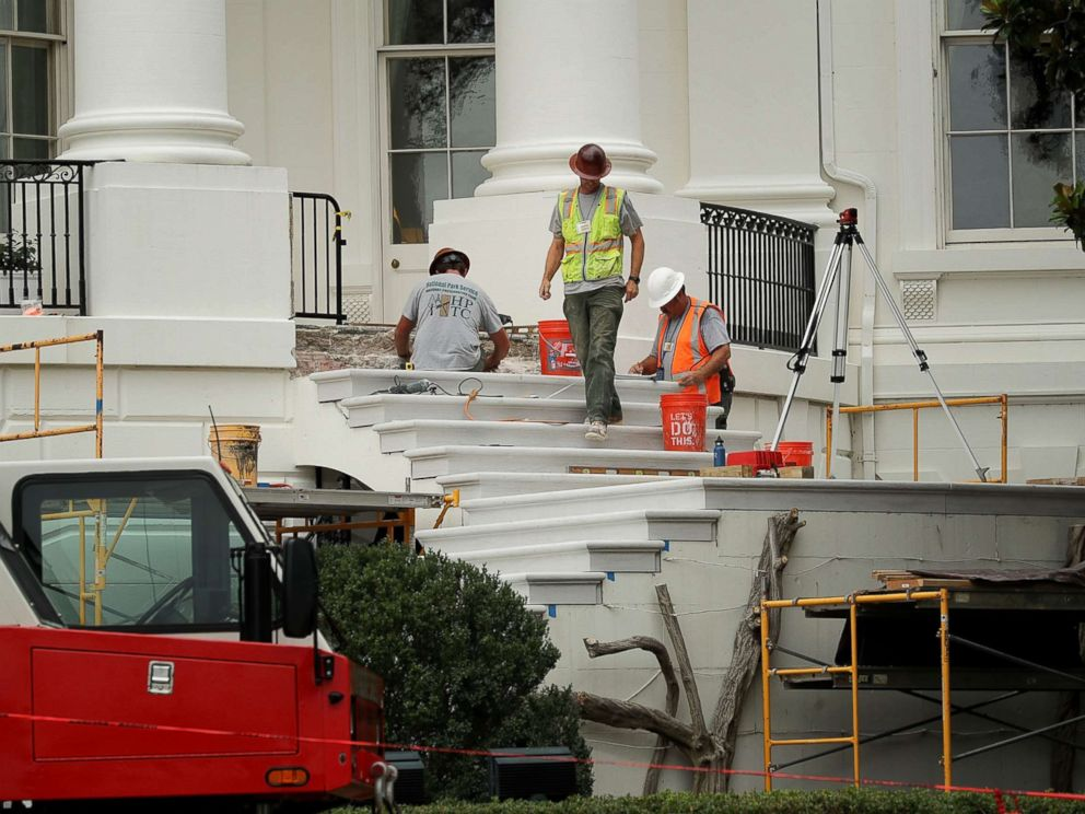 PHOTO: Workers repair the South Portico steps, part of a large renovation project at the White House August 11, 2017 in Washington, DC.